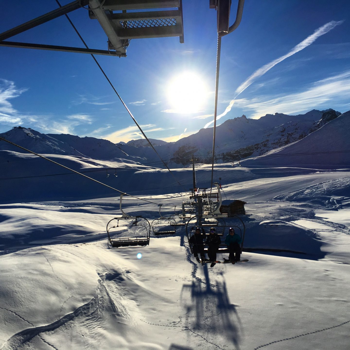 chairlift-and-sun